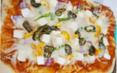 Pizza can be topped with a variety of toppings, sauces, and cheeses.
