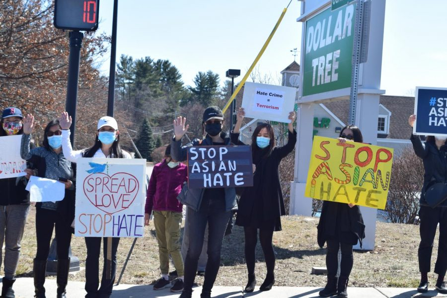 Westford residents protest on Boston Road in anti-Asian Hate Rally after Atlanta spa shooting.