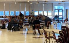 Students working in the cafeteria before the full return. What will the changes to classes look like when students return to the building on April 26?