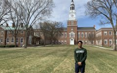 Senior Arpit Rao poses in front of Dartmouth College, where he will his education after high school.