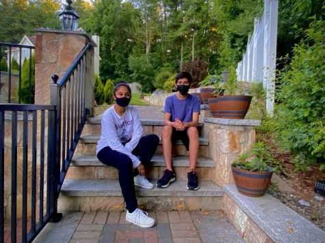 Abhinav Wadhwa and Muskan Bansal, two sophomores running the India Covid Relief Fundraiser, pose on some steps for a picture.