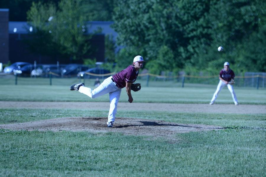 Senior captain Kyle Eliasen pitches the ball.