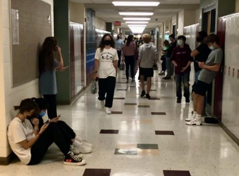 The students navigate the halls during their passing time, trying to get to their next block.