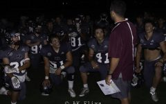 WA Grey Ghosts gather around Coach Rich during the Dracut game.