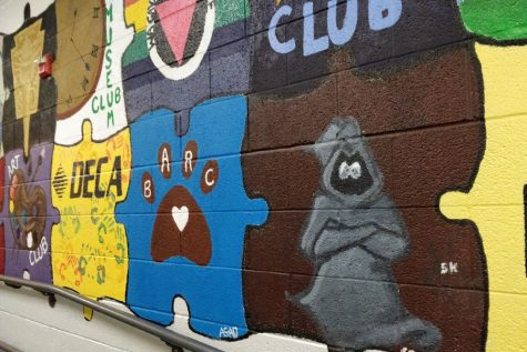 The Grey Ghost painting that is part of the mural that is on the wall that leads to the cafeteria. If the mascot image is changed, the mural may need to be painted over.