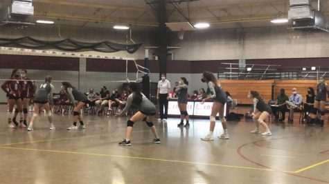The Girls Varsity team readys for the incoming serve by Lowell High School.
