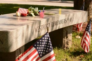 A bench sits on the Town Common, dedicated to Westford residents James F. Hayden and Susan A. MacKay who lost their lives during 9/11. Hayden and MacKay's names are inscribed on either sides of the bench.
