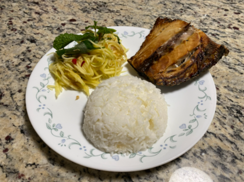 A common Khmer dish of mango salad with mint (left), white rice (middle), and baked mackerel fish (right).